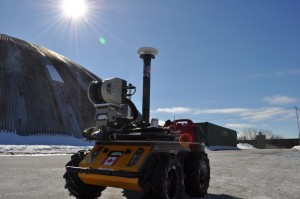ASRL Husky autonomous mobile robot in front of the MarsDome