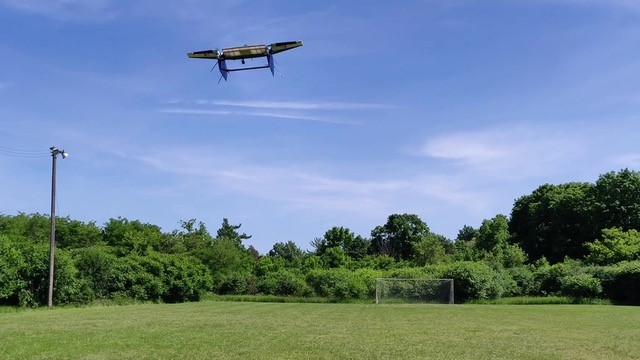 A vertical take-off and landing (VTOL) UAV in flight for biological science investigation