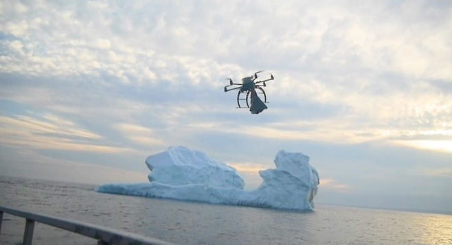 Drone flying over glacial waters