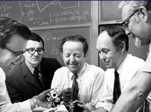Professors engaging with a gadget in 1970