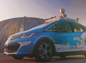 autoronto's self driving car in front of utias dome